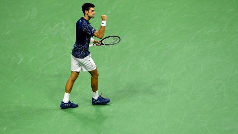Novak Djokovic of Serbia celebrates victory following his men's singles semifinal match against Japan's Kei Nishikori.