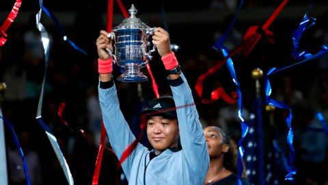 Naomi Osaka, of Japan, holds the trophy after defeating Serena Williams in the women's final of the U.S. Open tennis tournament, Saturday, September 8 in New York.
