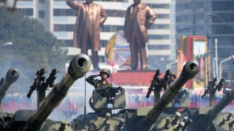 North Korean soldiers salute as they ride tanks during a military parade and mass rally on Kim Il Sung square in Pyongyang on September 9, 2018.