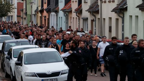 People take part in a march in Koethen, eastern Germany, on Sunday.