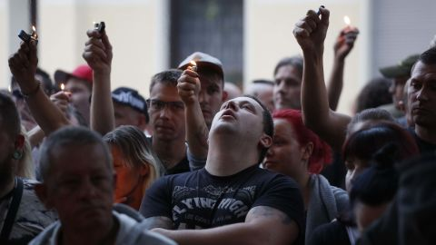 """People with lighters are pictured after the """"funeral march"""" in Koethen on Sunday."""