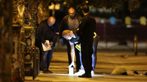 French police investigate the scene where a man attacked people with a knife Sunday night in Paris.