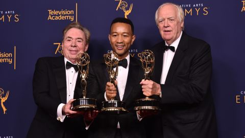 """Sir Andrew Lloyd Webber, John Legend and Tim Price became the latest EGOT winners thanks to """"Jesus Christ Superstar Live in Concert's"""" Emmy win for outstanding variety special. Here the trio pose in the press room after their win at the Microsoft Theater on September 9, 2018 in Los Angeles, California."""