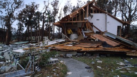 065106 02: A man stands in a partially destroyed house September 27, 1989 in South Carolina. Hugo is ranked as the eleventh most intense hurricane to strike the US this century and is rated the second costliest with over seven billion dollars in damages. (Photo by Alan Weiner/Liaison)