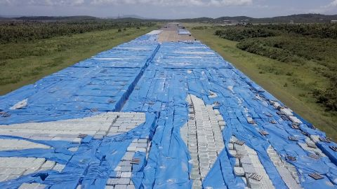 Stacks upon stacks of bottled water sit near a runway in Ceiba, Puerto Rico, on September 12, 2018.