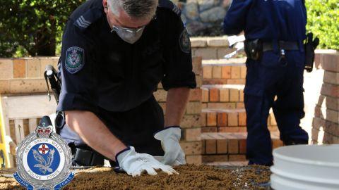 Police search the former Dawson home in April.