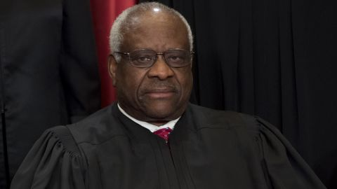 US Supreme Court Associate Justice Clarence Thomas sits for an official photo.