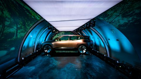 The concept car was unveiled inside a cargo jet that traveled to four cities in five days.
