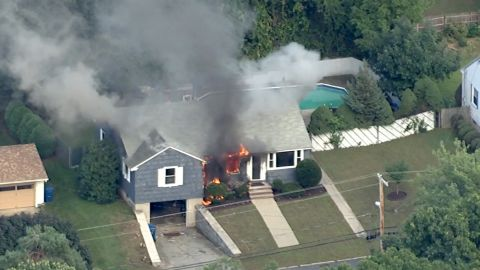 A house goes up in flames Thursday in northeastern Massachusetts north of Boston.
