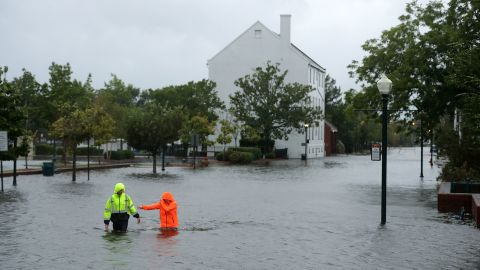 NEW BERN, NC - SEPTEMBER 13:  Residents walk in flooded streets as the Neuse River floods its banks during Hurricane Florence September 13, 2018 in New Bern, North Carolina. Coastal cities in North Carolina, South Carolina and Virginia are under evacuation orders as the Category 2 hurricane approaches the United States.  (Photo by Chip Somodevilla/Getty Images)