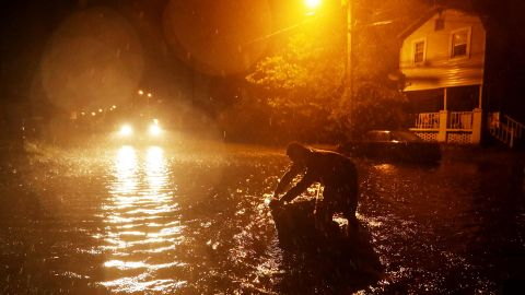 Michael Nelson floats in a boat made from a metal tub and fishing floats after the Neuse River went over its banks and flooded his street during Hurricane Florence September 13, 2018 in New Bern, North Carolina. Some parts of New Bern could be flooded with a possible 9-foot storm surge as the Category 2 hurricane approaches the United States.