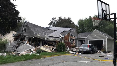 A house in Lawrence is reduced mostly to rubble Thursday after a series of explosions.