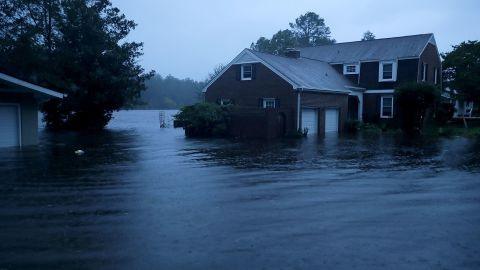 RIVER BEND, NC - SEPTEMBER 13:  The Trent River (background) overflows its banks and floods a neighborhood during Hurricane Florence September 13, 2018 in River Bend, North Carolina. Some parts of River Bend and the neighboring New Bern could be flooded with a possible 9-foot storm surge as the Category 2 hurricane approaches the United States.  (Photo by Chip Somodevilla/Getty Images)