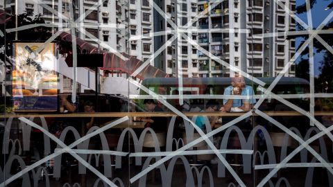 Residential buildings in Hong Kong are reflected in a McDonald's restaurant window, taped in preparation for Typhoon Mangkhut, on September 14. Hong Kong and Macau are currently in the typhoon's path.