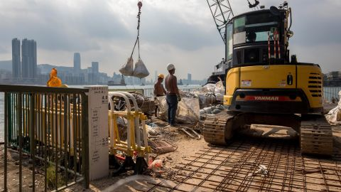 Workers lay sandbags at the waterfront of the Lei Yue Mun area of Hong Kong on September 14.