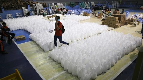 A volunteer moves through relief goods September 14 as Tuguegarao prepares for the typhoon's arrival.