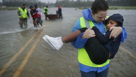 Volunteers from the Civilian Crisis Response Team  rescue three children in James City, North Carolina.