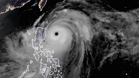 A satellite image shows the width and trajectory of Mangkhut as it approaches the Philippines on September 14.