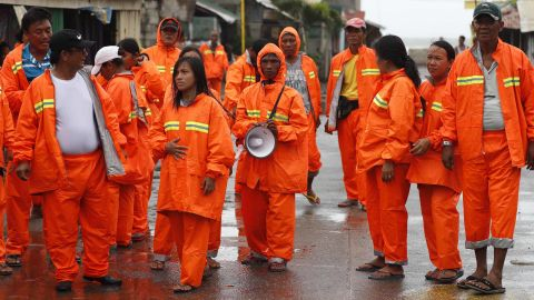 Officials conduct a patrol in Aparri ahead of the typhoon on September 14.