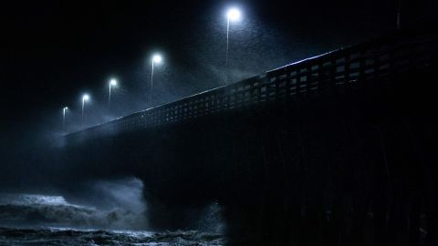 Waves crash into the Second Avenue Pier in Myrtle Beach on September 14.