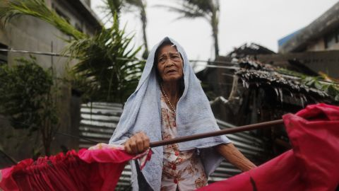 An elderly Filipino woman copes in the typhoon-hit town of Aparri, Philippines, on September 15.