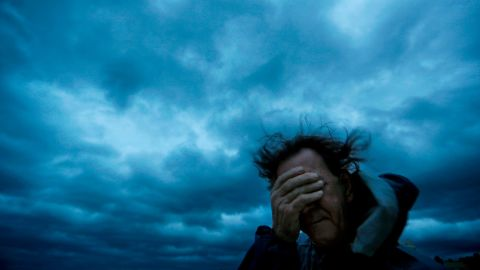 Russ Lewis covers his eyes from wind and sand in Myrtle Beach, South Carolina, on September 14.