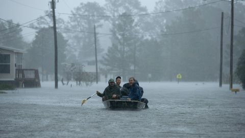 Volunteers help rescue people from their flooded homes in New Bern on September 14.