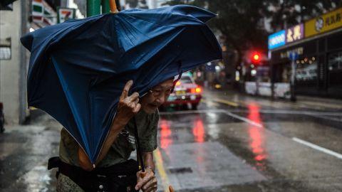 An elderly man waits for a taxi as Typhoon Mangkhut edges closer to Hong Kong, on Sunday, September 16.