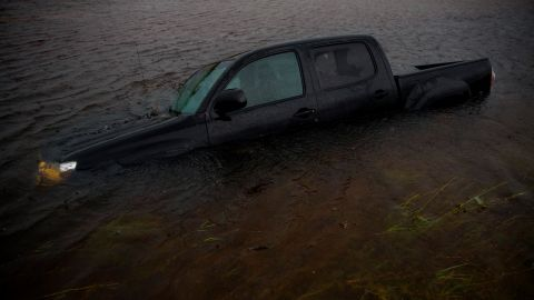 A truck is submerged in floodwaters in Jacksonville, North Carolina, on Saturday.