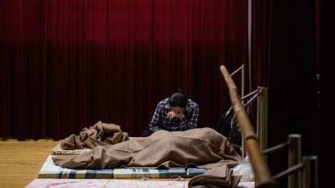 Hong Kong residents rest in a shelter on September 16.