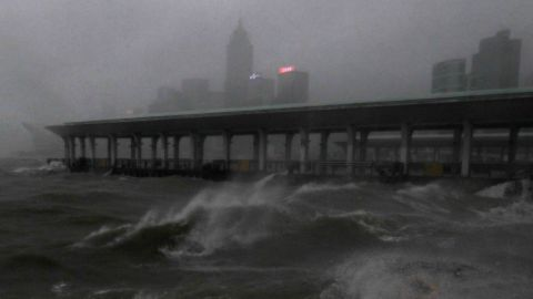 Strong winds churn waves on Hong Kong's Victoria Harbor.