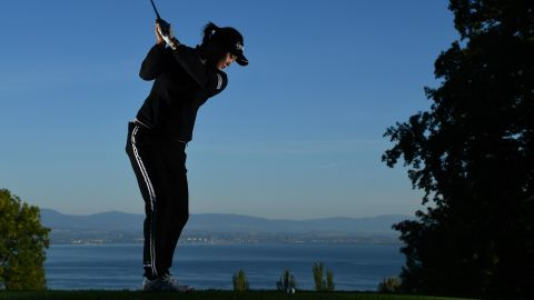 Some of the tees boast incredible views across Lake Geneva and the French Alps. Pictured is the second hole where South Korea's So-yeon Ryu is seen taking a shot.