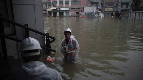 Rescuers evacuate areas in Macau.