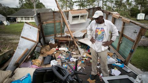 Tony Thompson stands in the wreckage of his mobile home as Florence moved inland over Newport, North Carolina, on September 16.