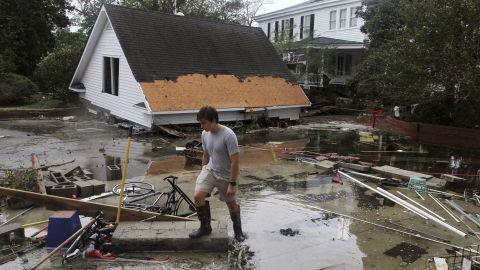 Joseph Eudi surveys debris and storm damage at a home in New Bern, North Carolina, on September 15.