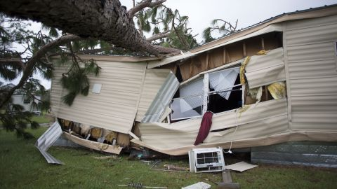A large tree lies on top of a mobile home in Newport, North Carolina, on September 16.