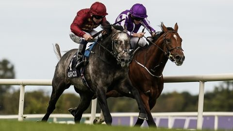 DUBLIN, IRELAND - SEPTEMBER 15:  Oisin Murphy riding Roaring LIon (L, red) win The QIPCO Irish Champion Stakes from Ryan Moore and Saxon Warrior (R) at Leopardstown Racecourse on September 15, 2018 in Dublin, Ireland. (Photo by Alan Crowhurst/Getty Images)