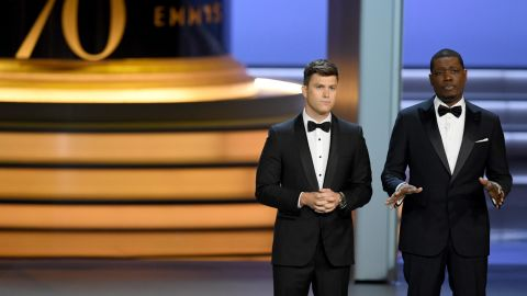 Colin Jost  and Michael Che speak onstage during the 70th Emmy Awards at Microsoft Theater on September 17, 2018 in Los Angeles, California.  (Photo by Kevin Winter/Getty Images)