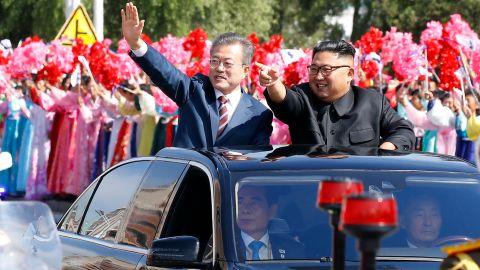 South Korean President Moon Jae-in and North Korean leader Kim Jong Un ride in a parade in Pyongyang, North Korea, on Tuesday, September 18.