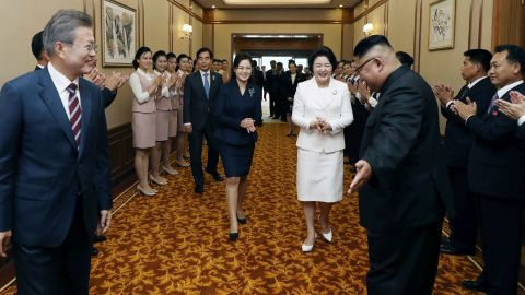 Kim and his wife, Ri Sol Ju, second from left, escort the South Korean leader and his wife, Kim Jung-sook, second from right, at the Paekwawon Guesthouse in Pyongyang on September 18.