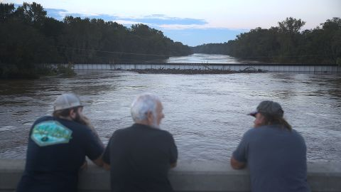People look out at the Cape Fear river on Tuesday near Fayetteville, North Carolina.