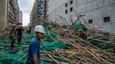 Workers in Hong Kong clean up scaffolding that had been knocked down by the storm.