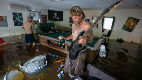 Ronnie Gainey pulls an electric guitar from his flooded home in Darlington, South Carolina.