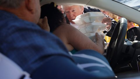 President Donald Trump hands out food at Temple Baptist Church, where food and other supplies were being distributed Wednesday, September 19, as part of Hurricane Florence recovery efforts in New Bern, North Carolina.