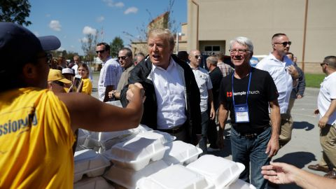 President Donald Trump visits the Temple Baptist Church, where food and other supplies are being distributed during Hurricane Florence recovery efforts, Wednesday, Sept. 19, 2018, in New Bern, N.C. (AP Photo/Evan Vucci)