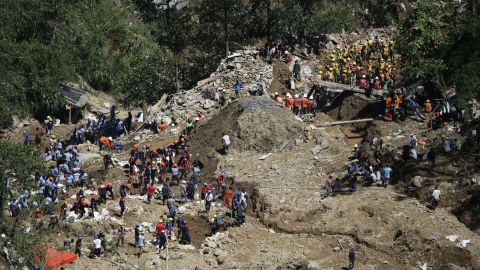 Rescuers in Itogon continue search operations on Wednesday, September 19. Dozens have been confirmed dead in the landslide, and dozens are still missing.