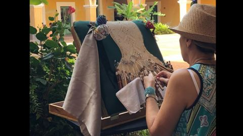 """Puerto Rican seamstresses are known for their detailed craftsmanship, such as the """"mundillo,"""" a handmade bobbin lace honored on the island."""