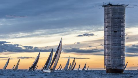 """Lauri Hänninen's shot captures the Helsinki lighthouse in the Baltic Sea during Finland's biggest off-shore sailing race. """"[The lighthouse] was under renovation and looked strangely sci-fi in the middle of light Nordic summer night,"""" says Lauri."""