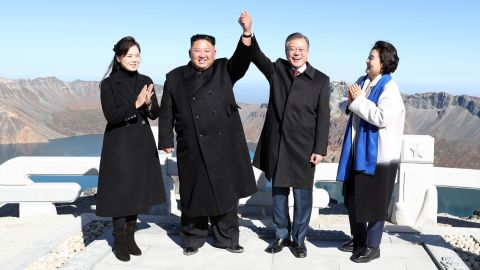 North Korean leader Kim Jong Un and his wife Ri Sol Ju pose with South Korean President Moon Jae-in and his wife Kim Jung-sook on the top of Mount Paektu in North Korea on Thursday, September 20.