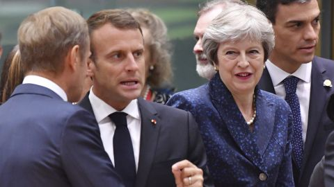 French President Emmanuel Macron, second left, speaks with European Council President Donald Tusk, left, as Spanish Prime Minister Pedro Sanchez, right, and British Prime Minister Theresa May, enter the room.